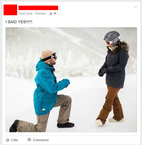 guy proposing to a girl on a mountain